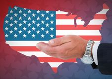 Hand of a business man against american flag. Digital composite of Hand of a business man against american flag Stock Image
