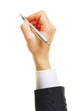 Hand of business man with ballpoint pen. Hand of business man writing with a ballpoint pen Stock Photography