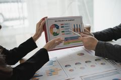 Hand of Business man and Business woman working on Data Charts,d stock images