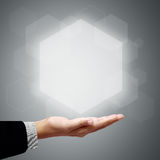 Hand of business man have Hexagon above Stock Photo