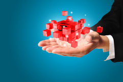 Hand of Business man hold cubic Royalty Free Stock Image