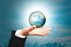 Hand of Business Man hold earth globe Royalty Free Stock Photo
