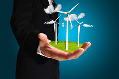 Hand of Business Man hold Turbine Power Generator. For illuatration ro any Stock Images