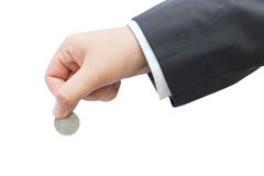 Hand of business man holding coin. Royalty Free Stock Photos