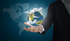 Hand of business man holding earth globe Stock Photo