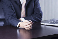 Hand of business man holding the pen Stock Images