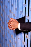 Hand of business man in jail Stock Photo