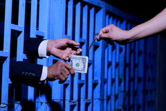 Hand of business man in jail royalty free stock photography