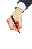 Hand of business man with pen. Hand of a business man writing with a black pen Royalty Free Stock Photo