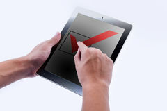 Hand of Business man point check mark. Option and box on Touch screen of Tablet PC Stock Images