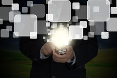 Hand of Business Man Pushing touch screen. Of mobile smart phone Stock Photo