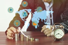 Hand of business man put money  on pile of coinsm, concept in growth, saving, finance Stock Image