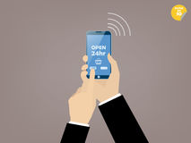 Hand of business man  touching smartphone. With online shop on the screen Stock Image