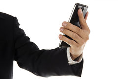 Hand of Business man using mobile smart phone Royalty Free Stock Image