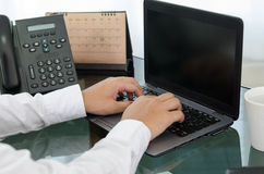 Hand of business man working in office Stock Image