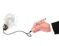 Hand of business man writing wire of light bulb Royalty Free Stock Photos