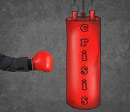 A hand in business suit is hitting the red punching bag. Royalty Free Stock Image