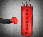 A hand in business suit is hitting the red punching bag. Royalty Free Stock Photography