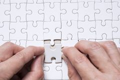 Hand business with white blank jigsaw puzzle Royalty Free Stock Photo