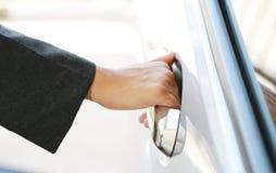 Hand business woman open car door Stock Image