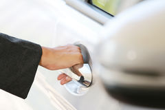 Hand business woman open car door. Stock Photos