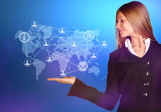 At the hand of business woman over a world map Royalty Free Stock Image