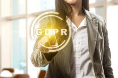 General Data Protection Regulation GDPR concept. Hand of business woman pointing GDPR text on virtual screen with office room background. Cyber security and stock images
