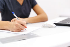 Hand business woman writing pen on paper on desktop Stock Images