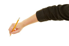 Hand of business woman writing with pencil. Hand of business woman writing with a pencil Royalty Free Stock Image