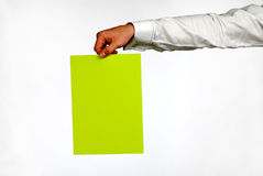Hand of  businessman. With  green sheet of  paper on  white background Royalty Free Stock Photography