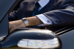 Hand of businessman in cabrio Stock Image