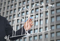 Hand of businessman drawing graphics a top point growing graph t Royalty Free Stock Photo