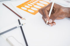 Hand of businessman drawing on paper with pencil Royalty Free Stock Photos
