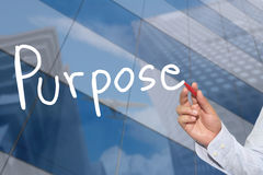 Hand of a businessman hand drawn a word of Purpose. Stock Photo