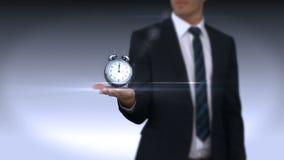 Hand of businessman holding alarm clock stock video