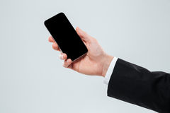 Hand of businessman holding blank screen mobile phone Stock Photography