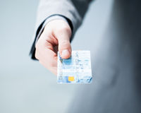 Hand of a Businessman Holding a Credit Card Royalty Free Stock Photography