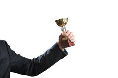 Hand of businessman holding Cup, concept success. Isolated on white Royalty Free Stock Photo