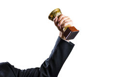 Hand of businessman holding Cup, concept success. Isolated on white Stock Image