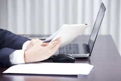 Hand of businessman holding a document Royalty Free Stock Photo