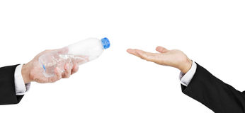 Hand of businessman holding, giving, receiving bottle of water, isolated on white background Stock Images