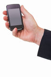 Hand of a businessman holding mobile phone Royalty Free Stock Images