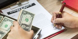Hand of businessman holding pen to write business document royalty free stock photo