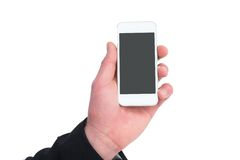 Hand of businessman holding smart phones Stock Photos