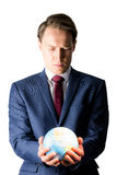 Hand of businessman holding terrestrial globe Stock Photography