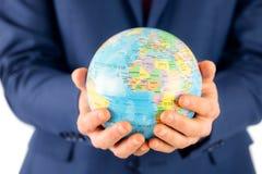 Hand of businessman holding terrestrial globe Stock Photos
