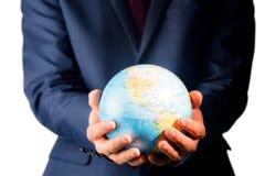 Hand of businessman holding terrestrial globe Royalty Free Stock Photos