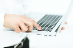 Hand of businessman on keyboard Stock Image