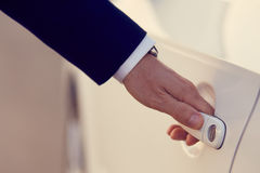 Hand of businessman opening a car door Royalty Free Stock Images