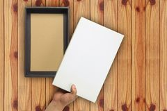 Hand of a businessman opening a white paper box and have copy sp Royalty Free Stock Photography